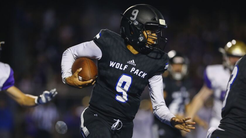 West Hills quarterback Jordin Young (9) rushes the ball in the second quarter against Santana.