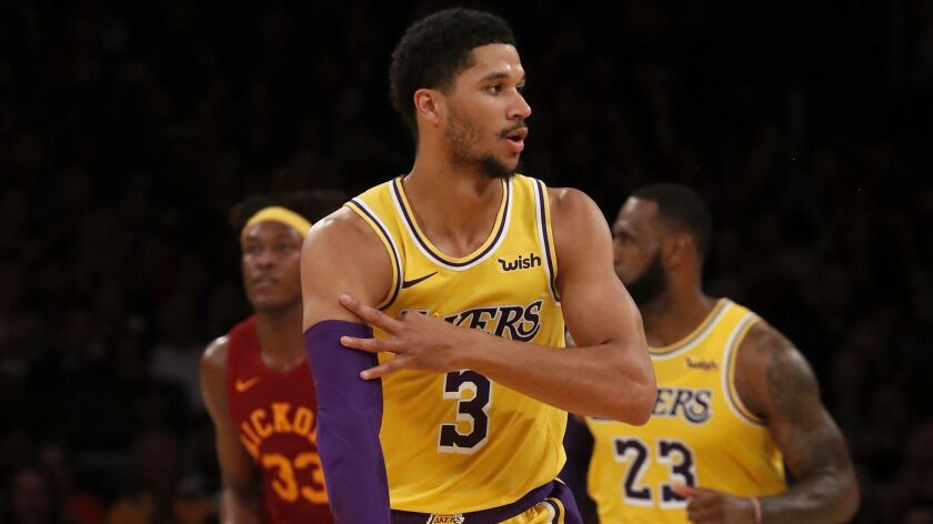 Lakers guard Josh Hart celebrates after scoring a three-point shot against the Pacers.