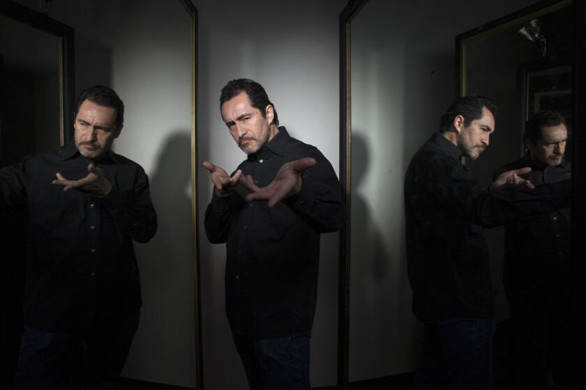 """After a rehearsal of the Mark Taper Forum's production of """"Zoot Suit,"""" Demian Bichir tries out one of his poses as the show's host, narrator and mythic zoot suiter known as El Pachuco."""