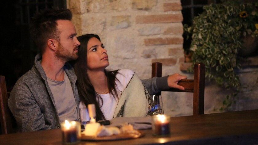 "(L-R) - Aaron Paul and Emily Ratajkowski in a scene from ""Welcome Home."" Credit: Vertical Entertainm"