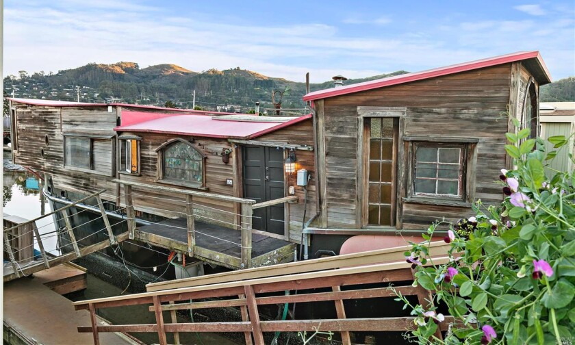 The decommissioned military vessel boasts two bedrooms, a bathroom and bohemian living spaces in 1,200 square feet.