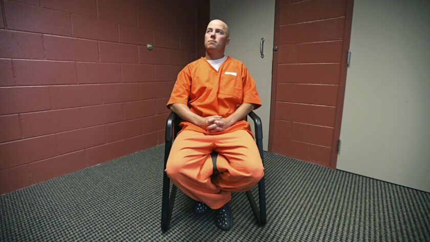 Inmate Russell Henderson looks on during a prison interview at Wyoming Medium Correctional Institution, in Torrington, Wyo. Henderson is serving two consecutive life sentences for the murder of Matthew Shepard in 1998.
