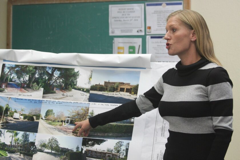 Muirlands Drive project representative Mandy Miller presents photos of surrounding homes along the street near the proposed development.