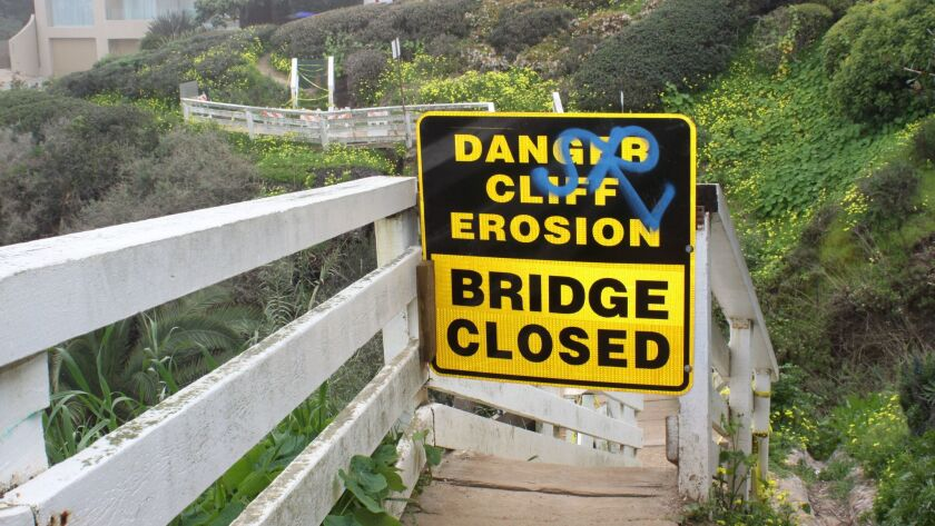 A sign was posted March 4 to say Coast Walk Trail bridge is closed.