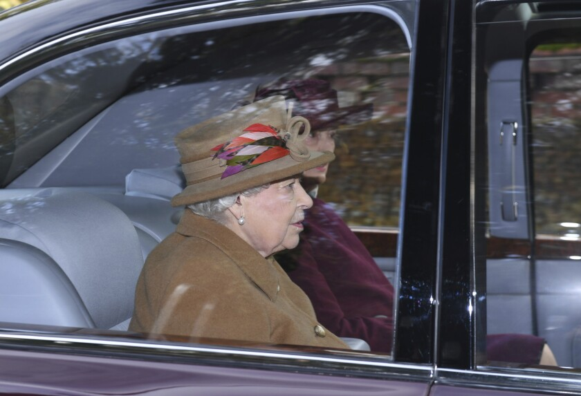 """Britain's Queen Elizabeth II arrives to attend a morning church service at St Mary Magdalene Church in Sandringham, England, Sunday Jan. 12, 2020. Prince Harry and his wife Meghan have declared they will """"work to become financially independent"""" as part of a surprise announcement saying they wish """"to step back"""" as senior members of the royal family. (Joe Giddens/PA via AP)"""