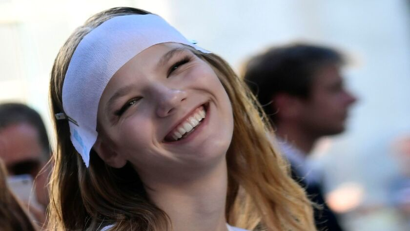 Model during fashion show in Milan. A smile should be natural, not perfect, one expert says.