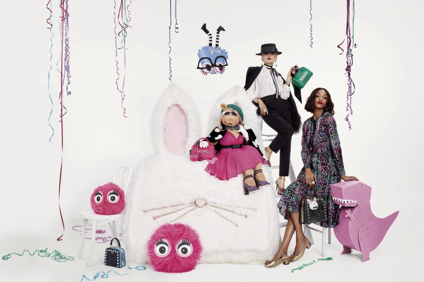 An image from the Kate Spade New York holiday collection and ad campaign starring Miss Piggy.