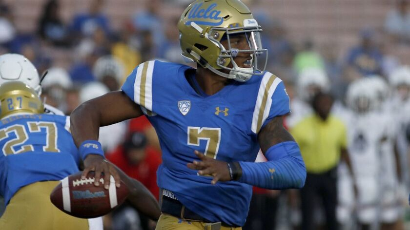 PASADENA, CALIF. - SEP. 1, 2018. UCLA quesrterback Dorian Thompson-Robinson scrambles out of the