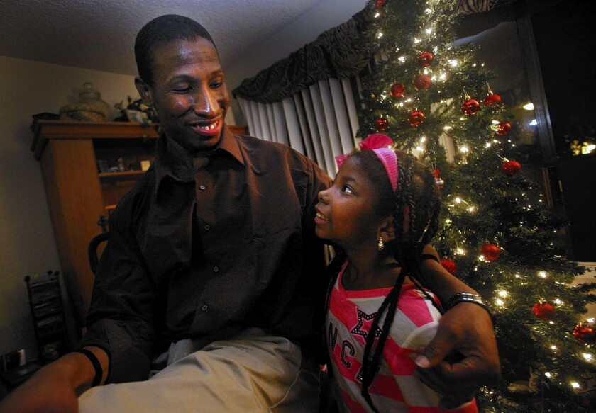 DeAndre Howard spends his first evening as a free man with his niece Briana Brown, 7, and other friends and family at his aunt Valdine Brown's home in Torrance.