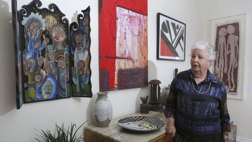Bea Roberts in her Carlsbad home with some of her many art pieces from around the world.