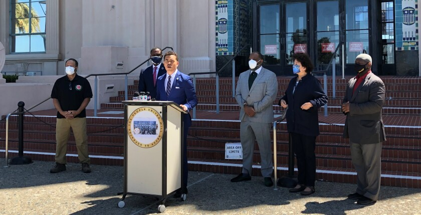 The Rev. Shane Harris and others urged the Board of Supervisors to support a federal policing bill.