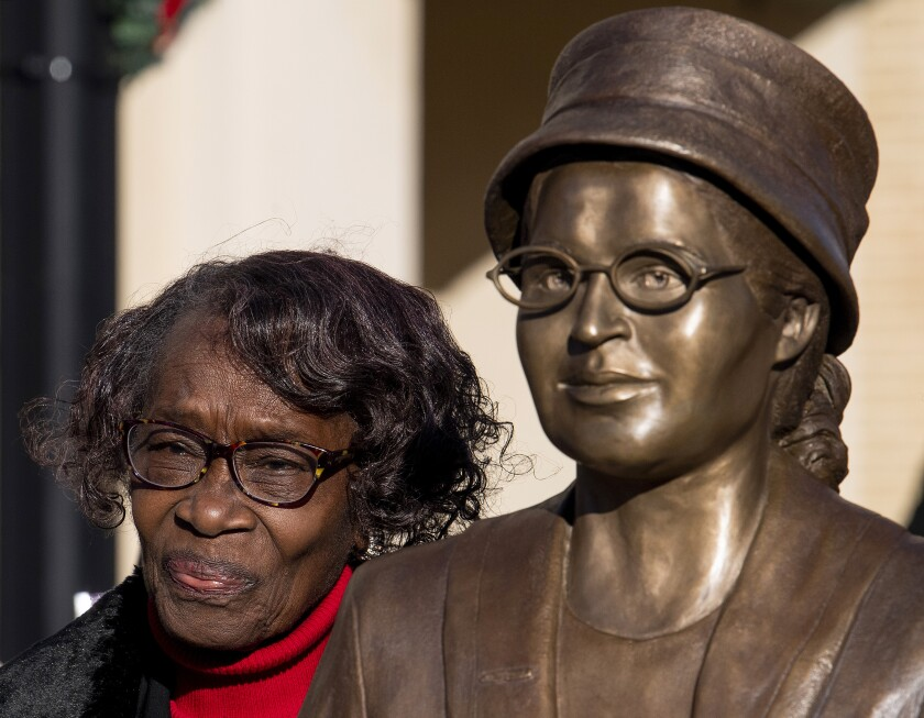 Mary Louise Smith, a plaintiff in the Browder vs. Gayle case that desegregated buses in Montgomery, stands beside the Rosa Parks statue after its unveiling event in downtown Montgomery, Ala., Sunday, Dec. 1, 2019, the anniversary of her arrest for not giving up her seat on a city bus. (Mickey Welsh/Montgomery Advertiser via AP)