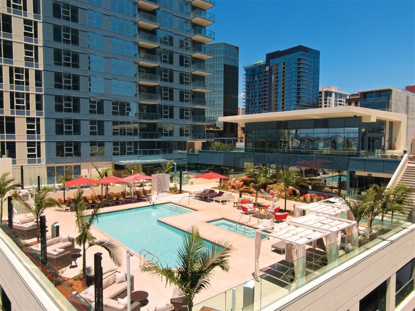 """""""It's like living in a luxury hotel,"""" resident Aya Yamanouchi said of amenities such as the lush, landscaped pool terrace at Savina by Bosa, in downtown San Diego."""