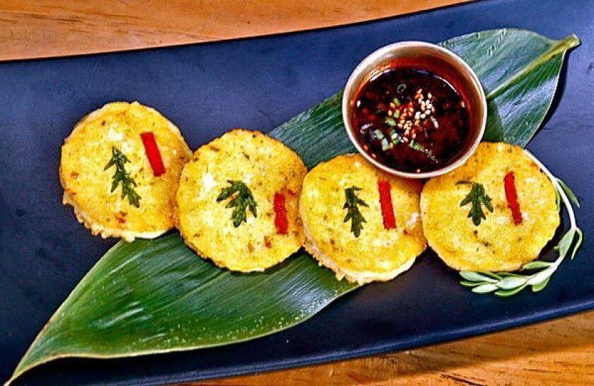 The mini mung bean pancakes, or bin dae duk, have a crepe-like texture.