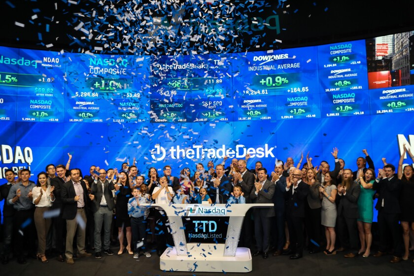 Employees and investors of the Trade Desk celebrated the company's initial public offering by ringing the closing bell at Nasdaq on Wednesday.