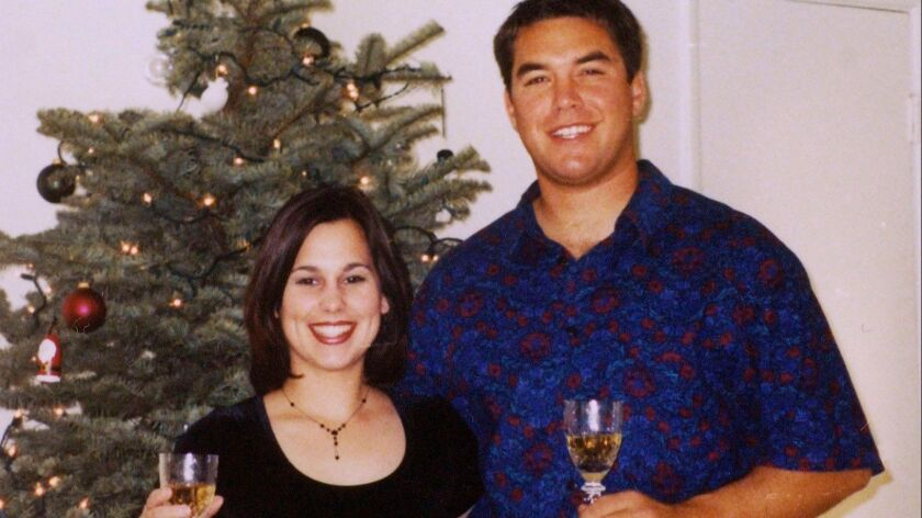 Laci Peterson and her husband Scott Peterson pose for a picture in this undated family photo.