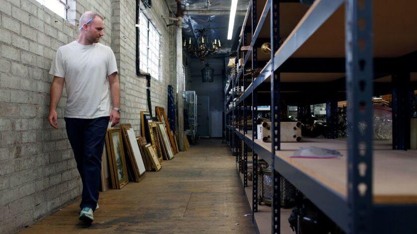 LOS ANGELES, CA-JUNE 25, 2019: Appraiser Ry Fillman walks through the warehouse at Andrew Jones Auct