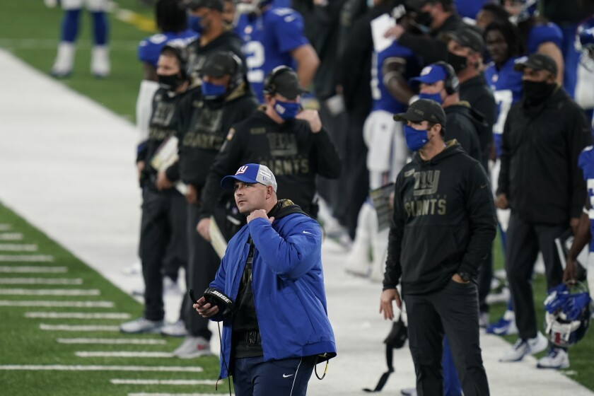 New York Giants head coach Joe Judge, front left, reacts during the second half of an NFL football game against the Philadelphia Eagles, Sunday, Nov. 15, 2020, in East Rutherford, N.J. (AP Photo/Seth Wenig)
