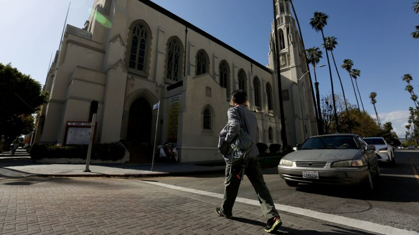 Seon Jin Kim walks to choir practice at St. James Episcopal Church in Los Angeles.