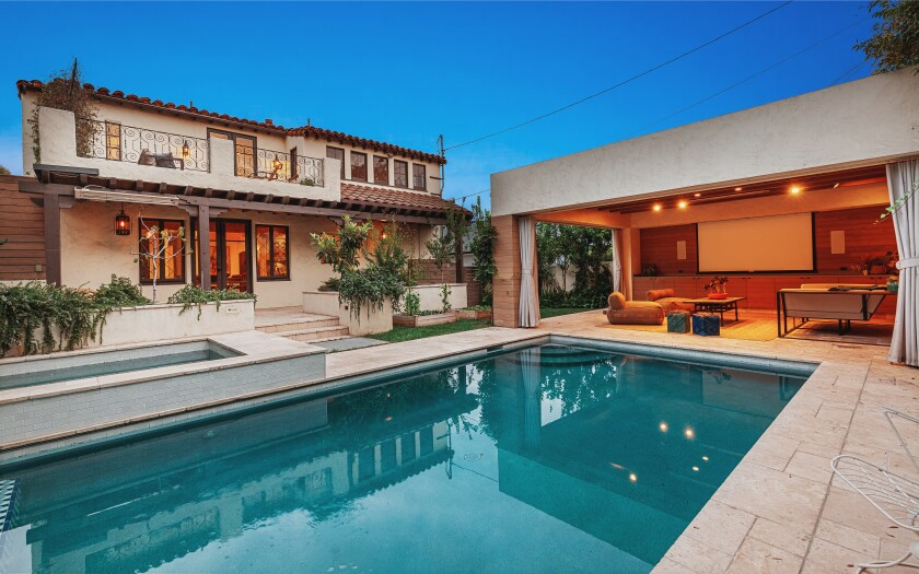 Built in 1932, the home includes a backyard with a pool and cabana surrounded by vegetable gardens and fruit trees.