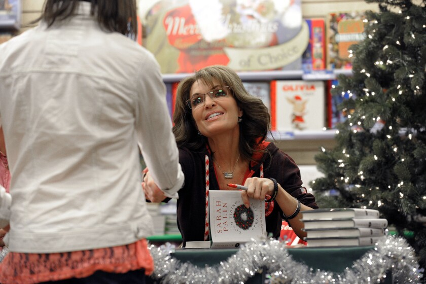 """Sarah Palin signs copies of her new book, """"Good Tidings and Great Joy: Protecting the Heart of Christmas"""" in Bethlehem, Pa."""