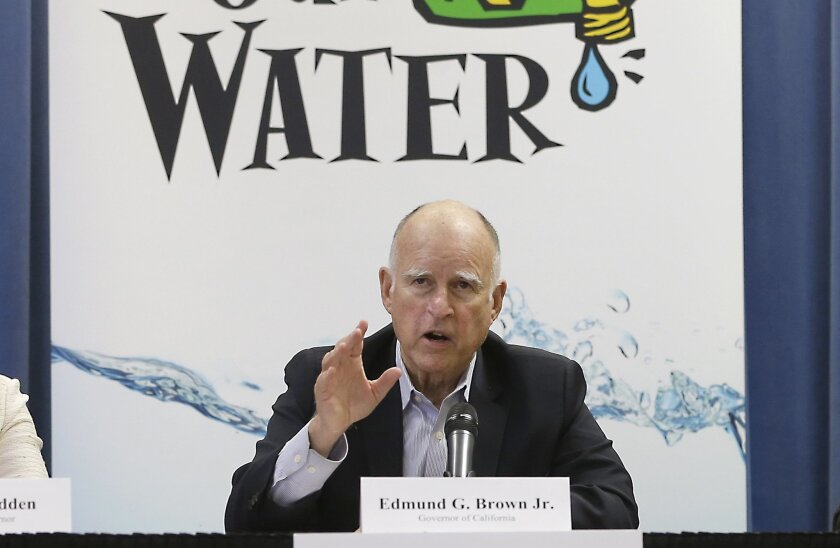 Gov. Jerry Brown responds to a question after a meeting with businesses affected by the drought at his Capitol office in Sacramento, Calif., Thursday, April 16, 2015. Cities expected to slash water use in the drought are revolting against Brown's mandatory water restrictions, and dozens of agencies