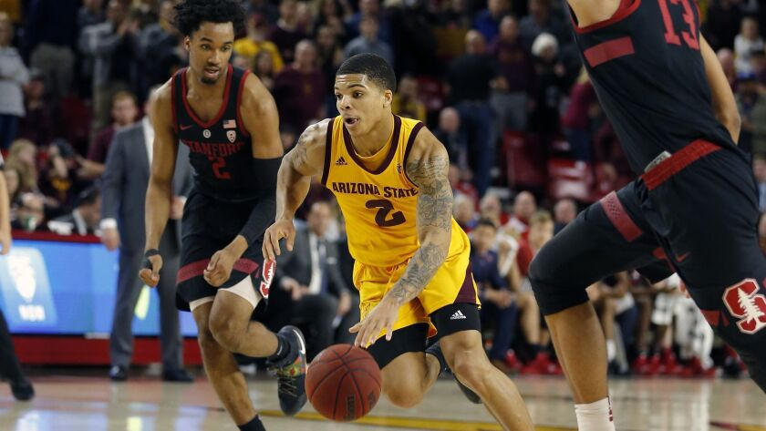 Arizona State guard Rob Edwards (2) drives between Stanford's Bryce Wills (2) and Oscar da Silva (13) during the second half on Wednesday in Tempe, Ariz.