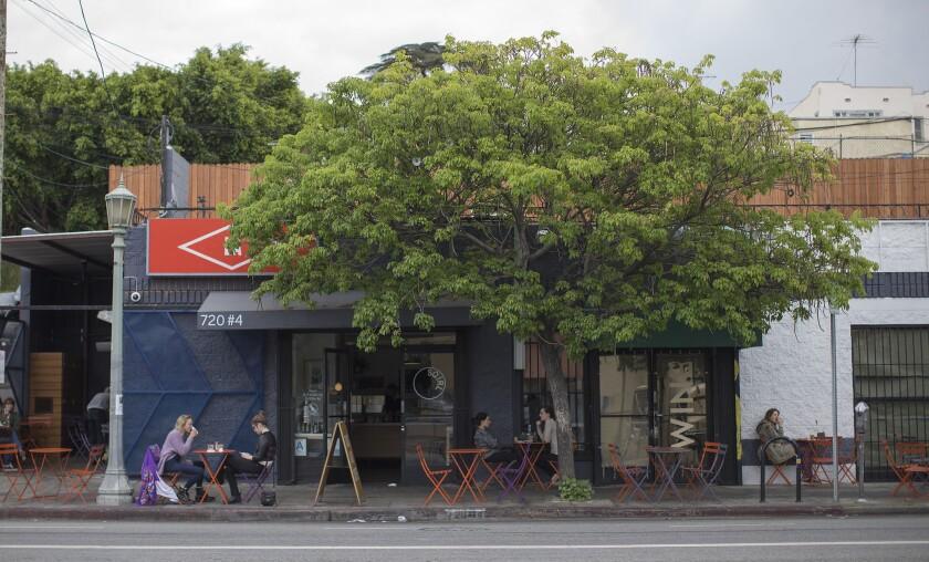 Customers dine outside Sqirl on Virgil Avenue in Virgil Village.