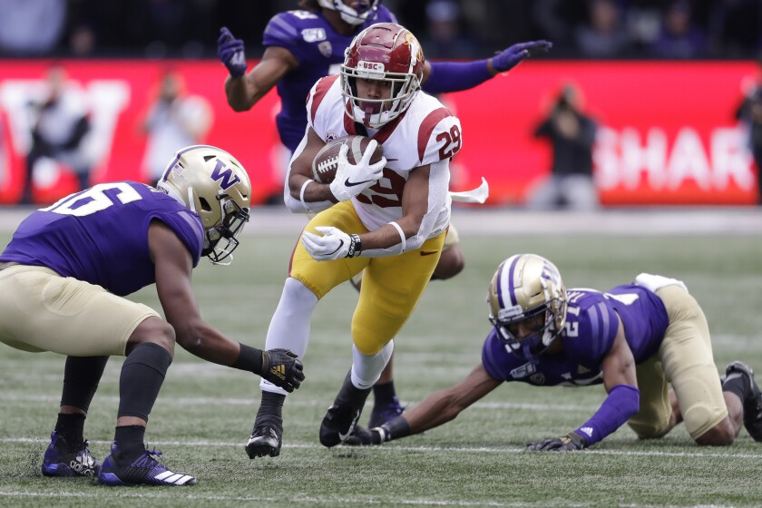 USC's Vavae Malepeai carries against Washington in the first half on Saturday in Seattle.