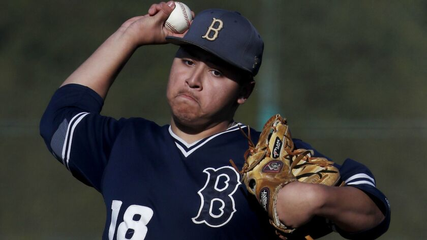 Birmingham starter Albert Garcia delivers a pitch against Harvard-Westlake during a game Feb. 19, 2019.