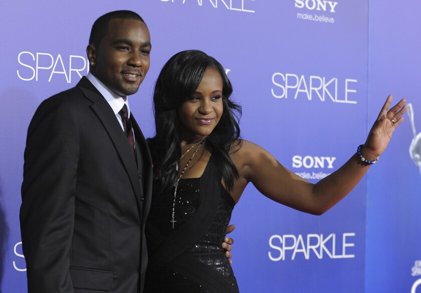 """FILE - In this Aug. 16, 2012, file photo, Bobbi Kristina Brown, right, and Nick Gordon attend the Los Angeles premiere of """"Sparkle"""" at Grauman's Chinese Theatre, in Los Angeles. An autopsy has found that Brown's ex-partner, Gordon, 30, died from an accidental drug overdose. The medical examiner in Seminole County, Fla., says Gordon overdosed on heroin on New Year's Day, Jan. 1, 2020. (Photo by Jordan Strauss/Invision/AP, File)"""