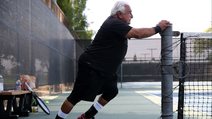 LOS ANGELES, CA-MAY 30, 2019: Rocky Garcia, a retired union representative, stretches after playing