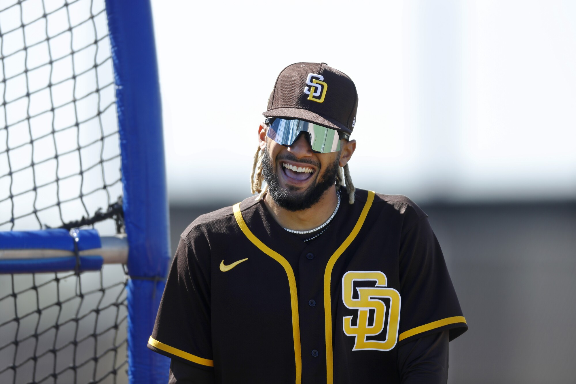 San Diego Padres' Fernando Tatis Jr. smiles as he walks off after batting during a spring training practice in Peoria.