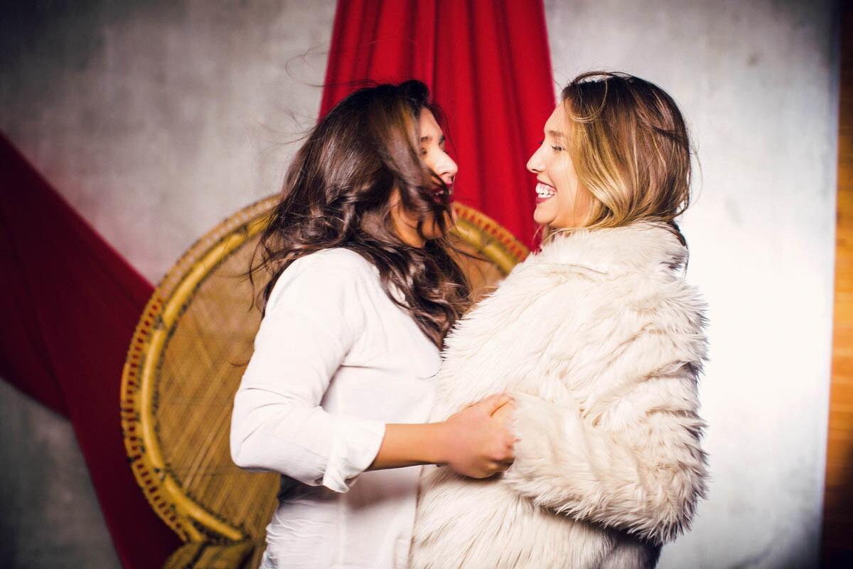 Jennie Nelson (light hair) and Bekah Leon during their blind date photo shoot at Boudoir Divas Photo Studio. (Marissa Boucher)