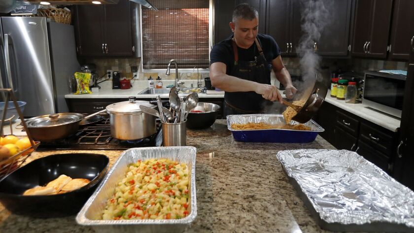Steve Rivera, 43, a Transportation Security Administration agent, makes Spanish rice at his home in
