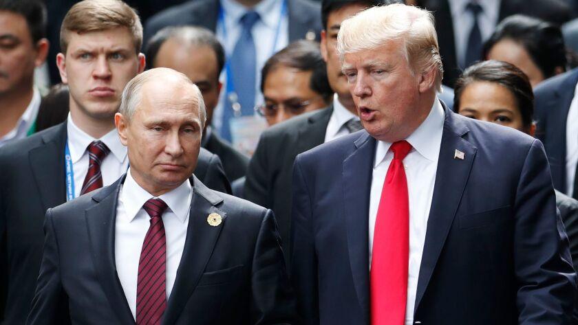 FILE - In this Nov. 11, 2017 photo, U.S. President Donald Trump and Russia's President Vladimir Puti