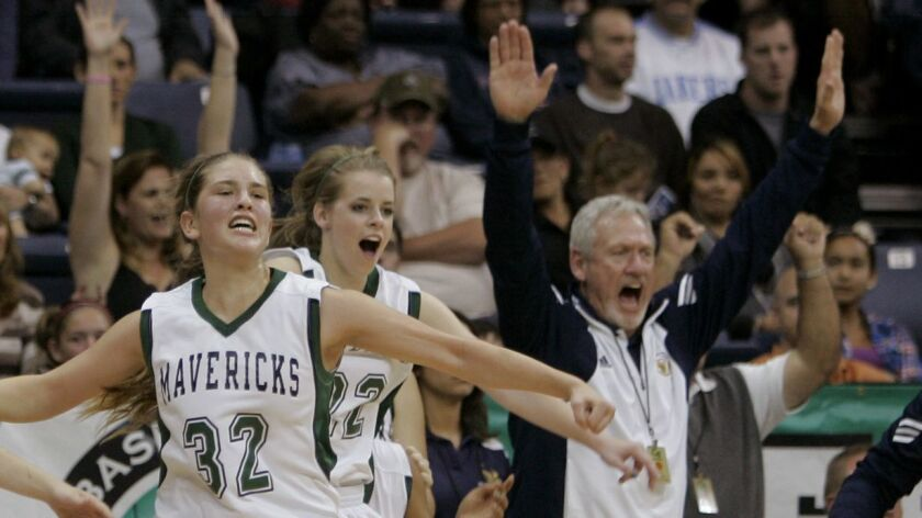 An assistant coach with LCC at the time, Mike Seaman cheers the Mavs' girls basketball title in 2011.