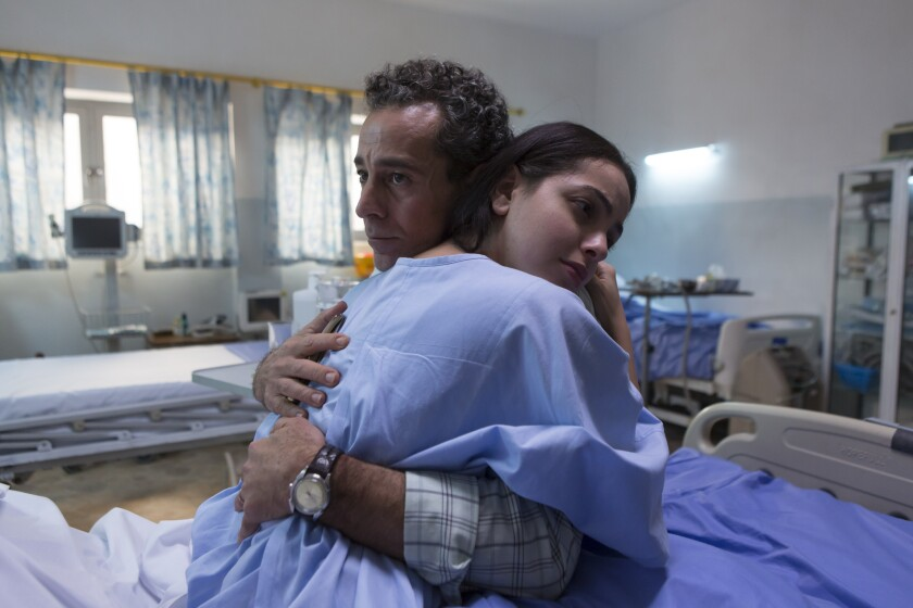 "Waleed Zuaiter and July Namir as father and daughter in ""Baghdad Central."""
