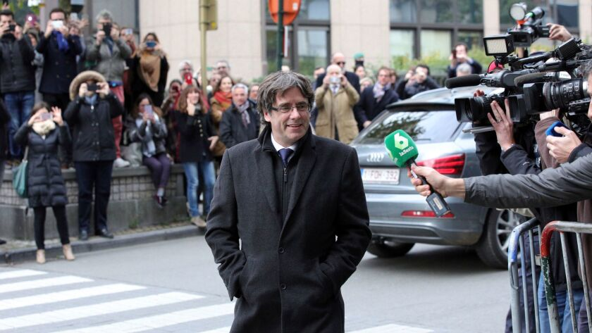 Sacked Catalonian President Carles Puigdemont arrives for a press conference in Brussels, Tuesday, O