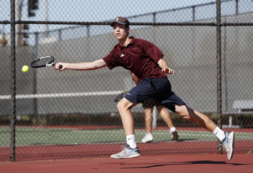 Estancia High's Jake Hastings chases down the ball against Costa Mesa in a No. 1 singles set during