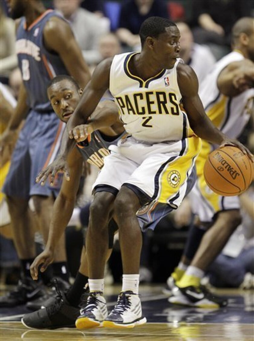 Indiana Pacers' Darren Collison (2) makes a move on Charlotte Bobcats' Kemba Walker, rear, during the first half of an NBA basketball game, Saturday, Jan. 7, 2012, in Indianapolis. (AP Photo/Darron Cummings)