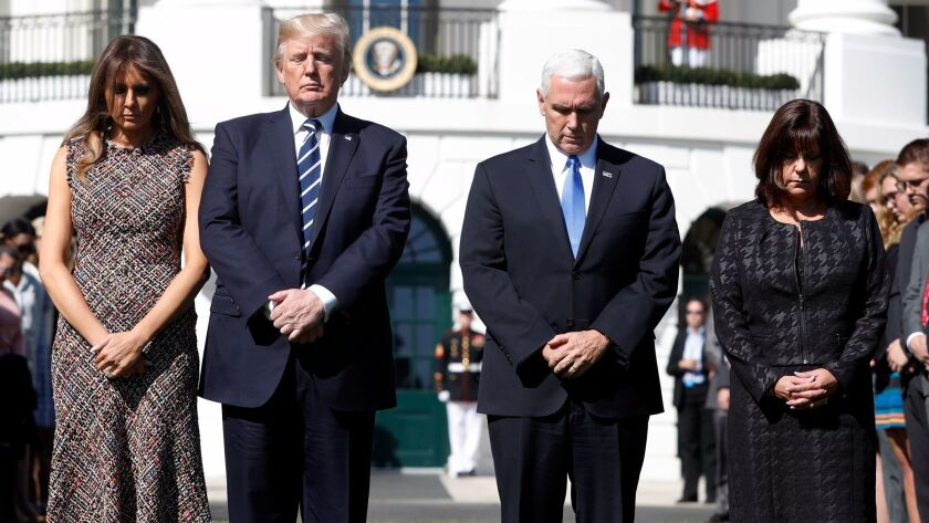 President Donald Trump and first lady Melania Trump stand with vice president Mike Pence and his wif