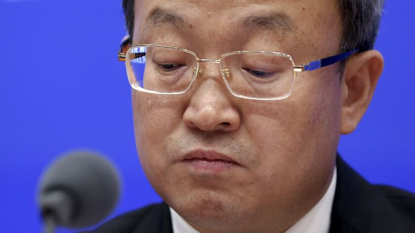 Trade negotiator Wang Shouwen, shown at a Beijing news conference earlier in the month, said on June 24, 2019, that both the U.S. and China must make concessions.