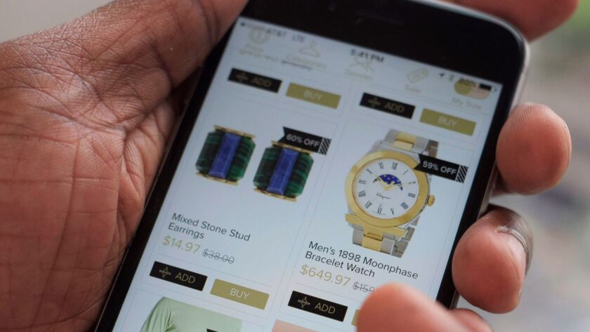 Discounted merchandise is shown on a smartphone using the Hafta Have app.