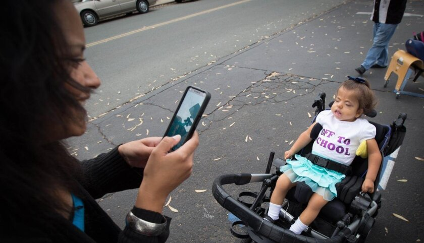 Damaris Higuera snaps a photo of her daughter, Sadie, just before the 3-year-old's first day of preschool, a momentous event for the little girl who formerly suffered from multiple life-threatening seizures.