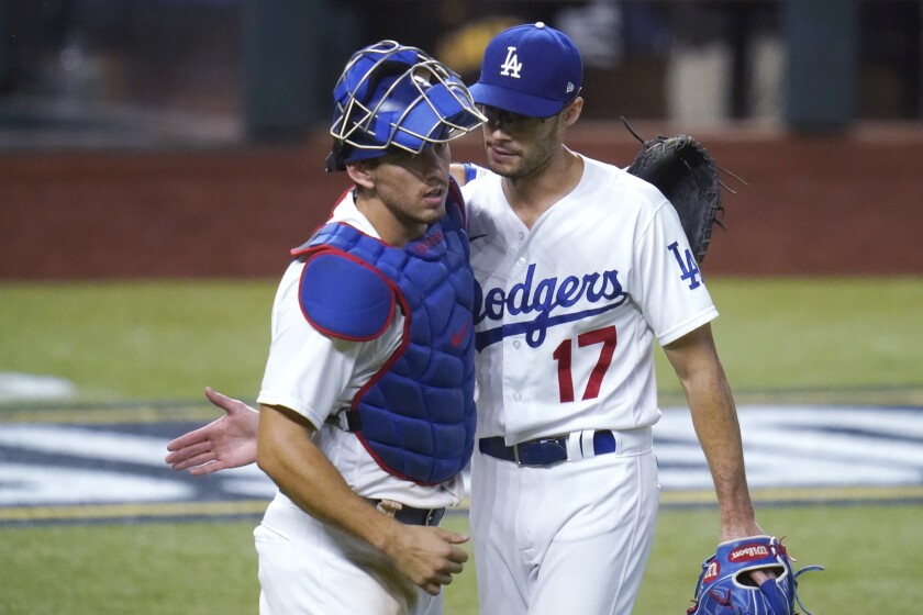 Dodgers reliever Joe Kelly is congratulated by catcher Austin Barnes after earning a save.