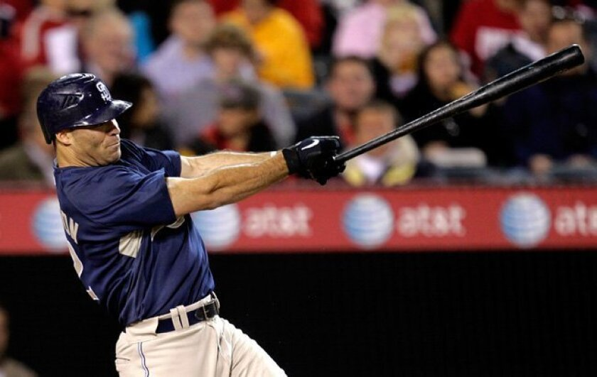 Padres' Scott Hairston hits an RBI single in the fourth inning of a spring training game in 2010.