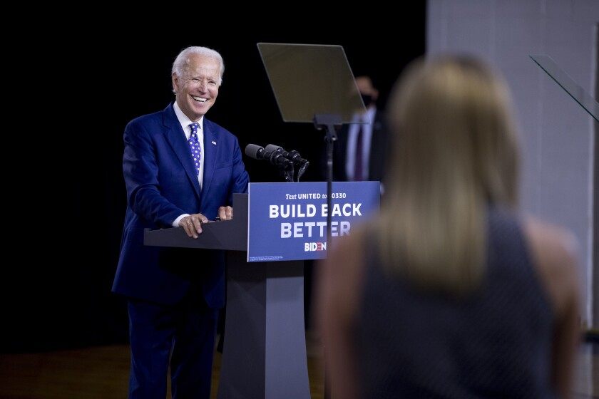 Democratic presidential candidate Joe Biden takes a question from a reporter at a campaign event in Wilmington, Del.
