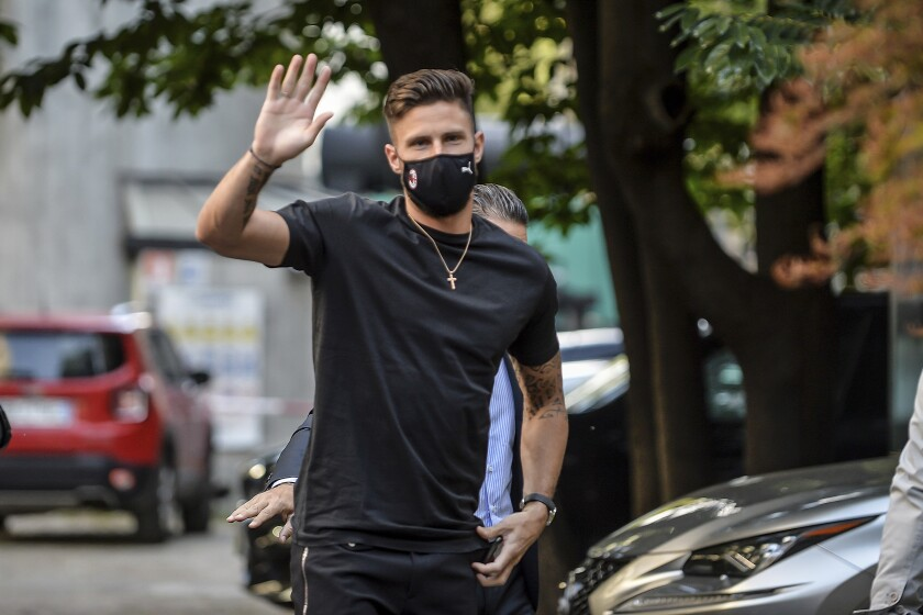 Newly hired AC Milan soccer club player Olivier Giroud arrives at a medical center in Milan, Italy, Friday, July, 16, 2021. (Claudio Furlan/LaPresse via AP)