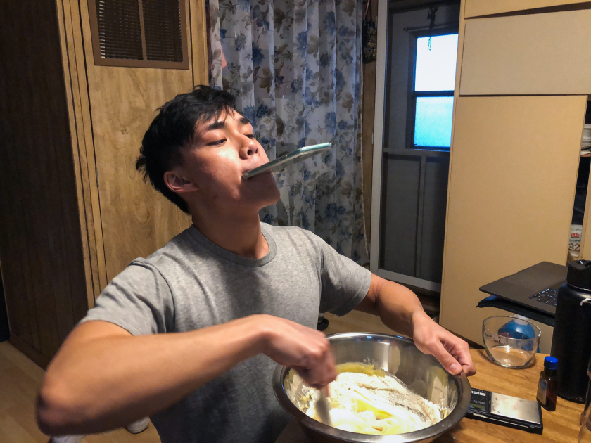 Newton Nguyen recording a cooking video.